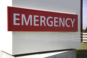 A red sign with white lettering on it saying, 'Emergency'.